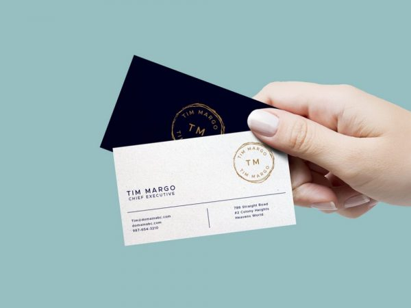 free-hand-holding-business-cards-mockup-psd-1000x750